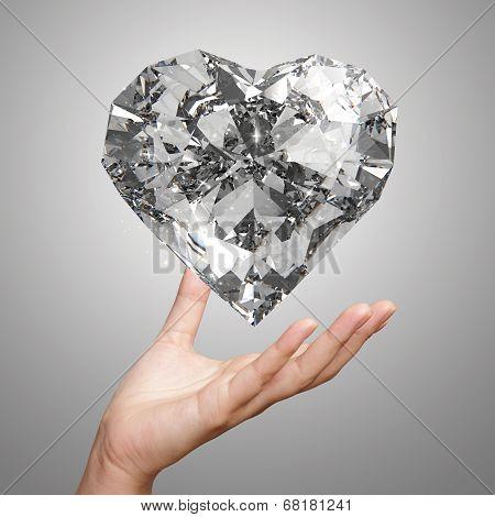 Hand Holding 3D Diamond Heart Shape As Concept