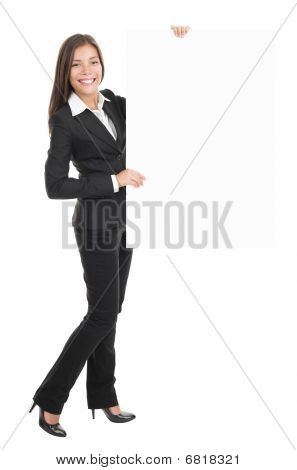 Businesswoman Holding Empty Billboard Sign