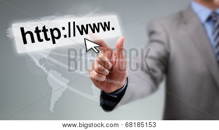 Businessman entering web page address on computer with cursor arrow, global communications and internet concept