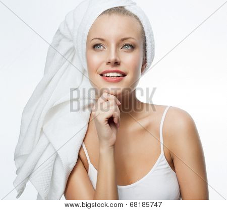 closeup portrait of attractive  caucasian smiling woman blond isolated on white studio shot lips toothy smile face hair head and shoulders looking at camera blue eyes tooth towel