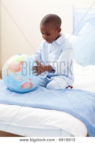 Little Boy Holding A Terrestrial Globe