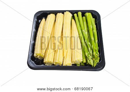 Asparagus And Baby Corn In Black Container Isolated On White Background.