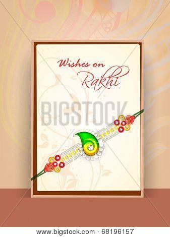 Beautiful greeting card design with rakhi for Happy Raksha Bandhan celebrations.