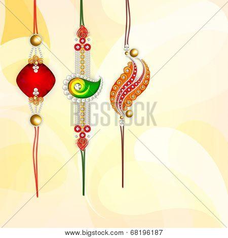 Beautiful rakhi's on bright yellow background for Happy Raksha Bandhan celebrations.