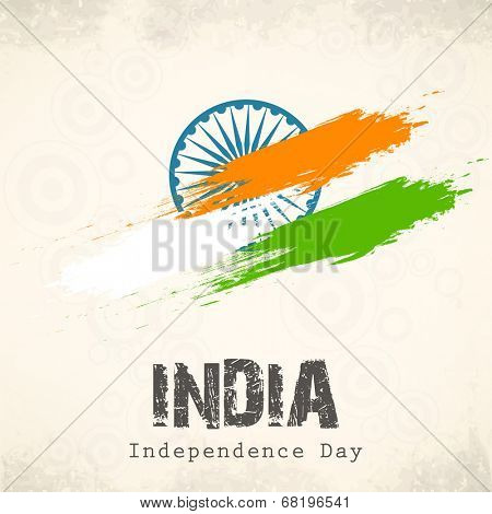 Indian Independence Day celebration with national flag colors and ashoka wheel on abstract grey background for 15th of August, Independence Day celebrations.