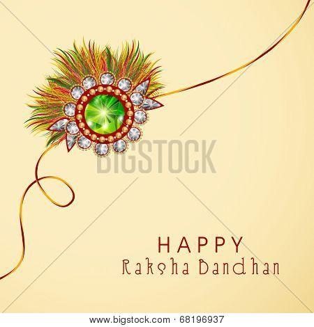 Beautiful rakhi on beige background for Happy Raksha Bandhan celebrations.