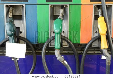 Several Gasoline Pump Nozzles With White Paper At Petrol Station, Gasoline Industry