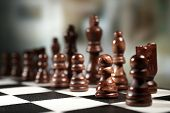 picture of battlefield  - Chess board with chess pieces on dark background - JPG