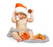 pic of bump  - Positivity child in Santa Claus red hat holds bump with silver tinsel - JPG