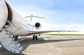 stock photo of jet  - Stairs with Jet Engine on a modern private jet airplane  - JPG