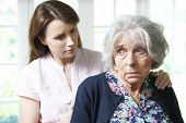 image of bereavement  - Adult Daughter Consoling Senior Mother At Home - JPG