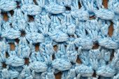 picture of thread-making  - A detailed close up of blue crocheted afghan blanket fills the frame of this image making it suitable for knitting background - JPG