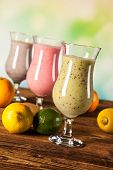 stock photo of fruit shake  - Healthy diet protein shakes fruits and sport and fitness concept  - JPG