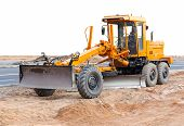 stock photo of earth-mover  - Road grader  - JPG
