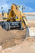 pic of wheel loader  - Wheel loader excavator parked at construction site