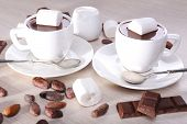 pic of chocolate spoon  - Cups of hot chocolate on table - JPG