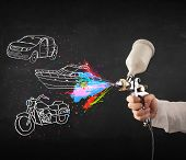 image of airbrush  - Man with airbrush spray paint with car - JPG