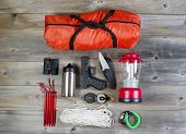 stock photo of personal safety  - Overhead view of hiking gear and personal protection pistol and knife placed on rustic wood - JPG