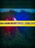picture of criminology  - Yellow crime scene cordon tape over a blured body of a man in the grass unidentifiable person - JPG
