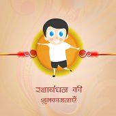 stock photo of rakhi  - Happy cute little boy holding a big rakhi with wishes on occasion of Happy Raksha Bandhan celebrations - JPG
