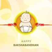 foto of rakhi  - Cute little boy picture decorated rakhi on shiny yellow background for Happy Raksha Bandhan celebrations - JPG