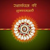 image of rakhi  - Beautiful rakhi on red and green background for Happy Raksha Bandhan celebrations - JPG