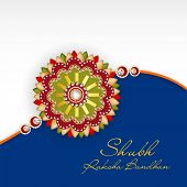 picture of rakhi  - Beautiful rakhi on grey and blue background for the occasion of Happy Raksha Bandhan celebrations - JPG