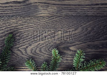 Fir Branch On Stained Oak Table From Above