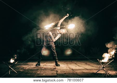 Active European Guy Carries Out Tricks For Fire Show Night