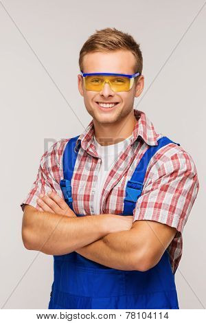Young smiling repairman in eyewear
