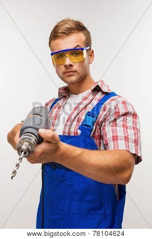 Serious repairman with drill