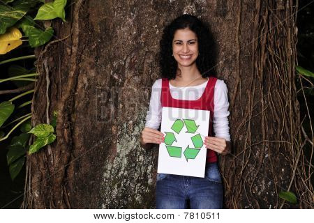 Recycling: Woman In The Forest Holding A Recycle Sign