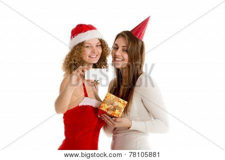 Two girls taking selfie in cristmas costumes horizontal