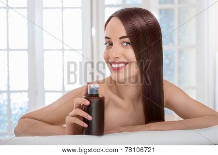 Woman taking care of hair in spa salon