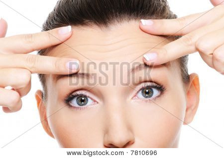 Female Face With Wrinkles On Forehead
