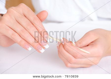 Female Removing Cuticle From Fingers
