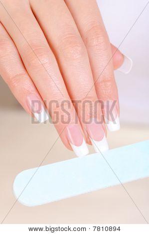 Female  Polishing Nails On Hand With Nailfile