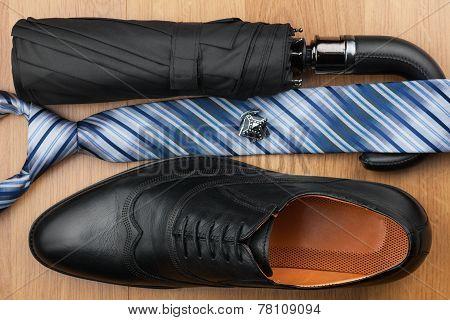 Classic Mens Shoes, Tie, Umbrella,cufflinks On The Wooden Floor