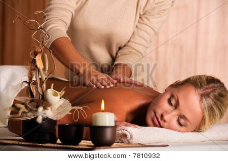 Masseur Doing  Massaging  Back Of A Beautiful Young Woman