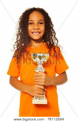 Black African girl with winners cup prize