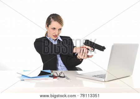 Businesswoman Pointing Gun To Computer Laptop Sitting At Office Desk Desperate And Stressed