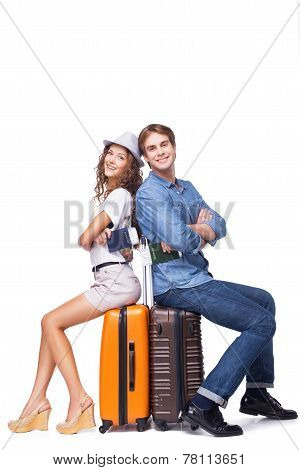 Smiling couple is ready to travel