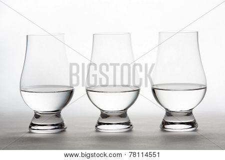 Vodka In Three Crystal Tasting Glasses