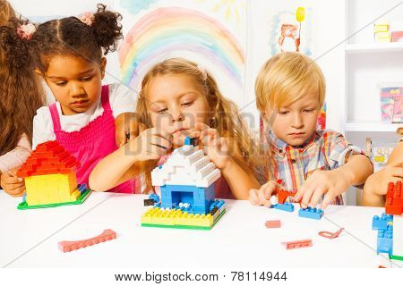 Group of kids playing with plastic blocks