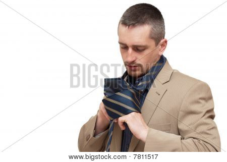 The Man Fastening A Tie