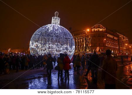 MOSCOW, RUSSIA - DECEMBER 12, 2014: The installation of a huge Christmas decorations, on Manezh Square