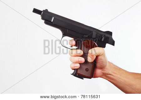 Hand with discharged gun on white background
