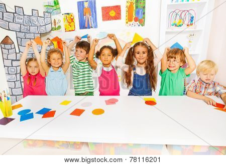 Happy boys and girls in the kindergarten art class