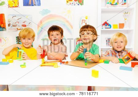 Group of kids in the class with toy tools