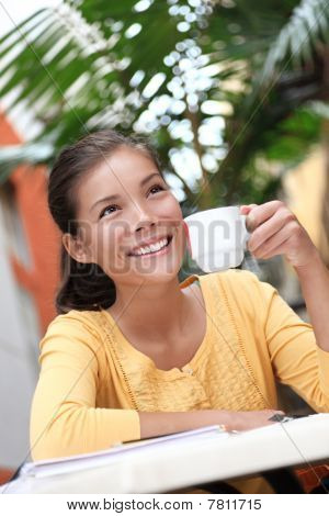 Woman Drinking Coffee In Cafe Outside
